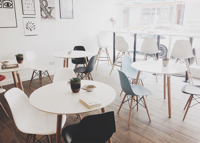 modern tables and chairs in commercial space
