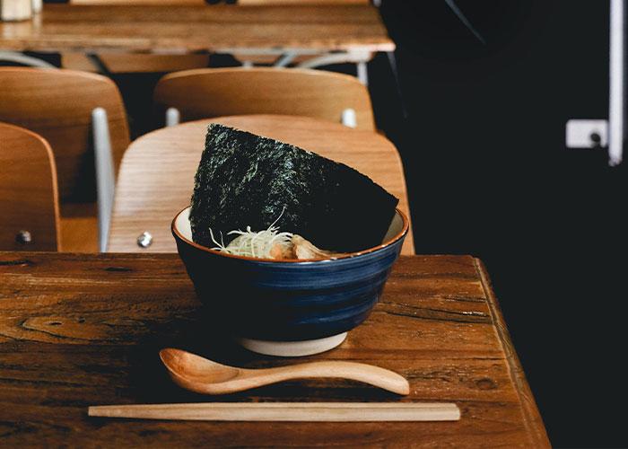 Ornate ramen bowl on wooden table